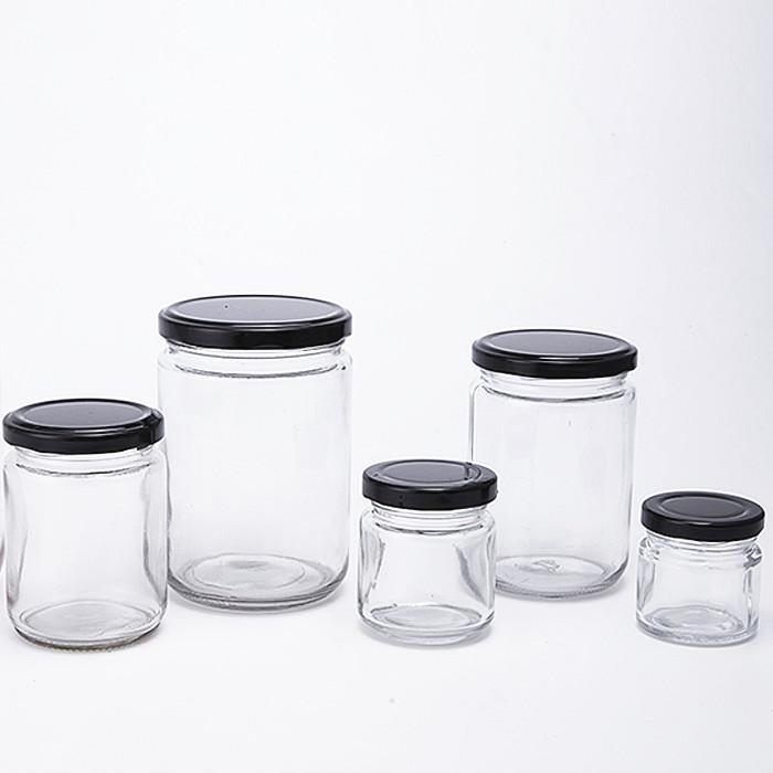 empty clear round glass jar